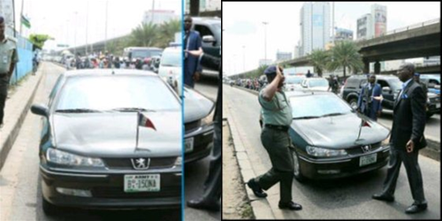 Former Gov of Lagos state, Babatunde Raji Fashola arresting a military man on brt lane