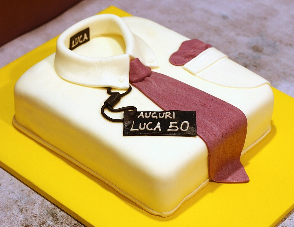 cake for a 50 year old man. Shirt with tie and pocket square