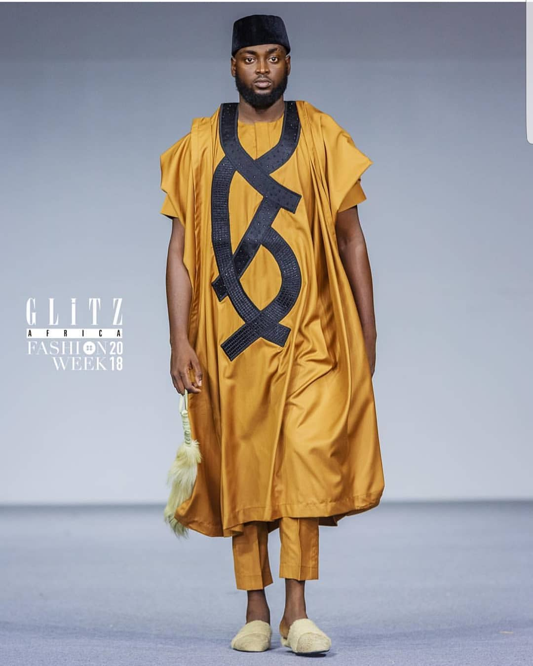 Yomi Casual gold and black  agbada on the runway